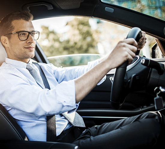 A man driving his car - Lagentium Insurance Brokers