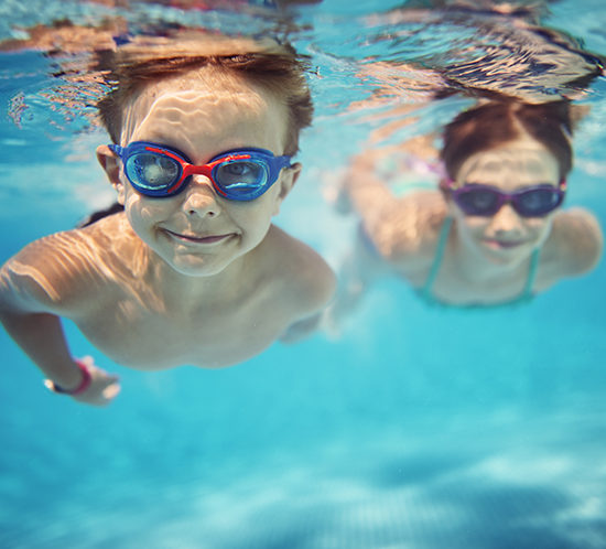Children swimming while on holiday - R Collins & Co Insurance Brokers