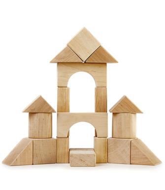 A wooden fort made out of wooden building blocks